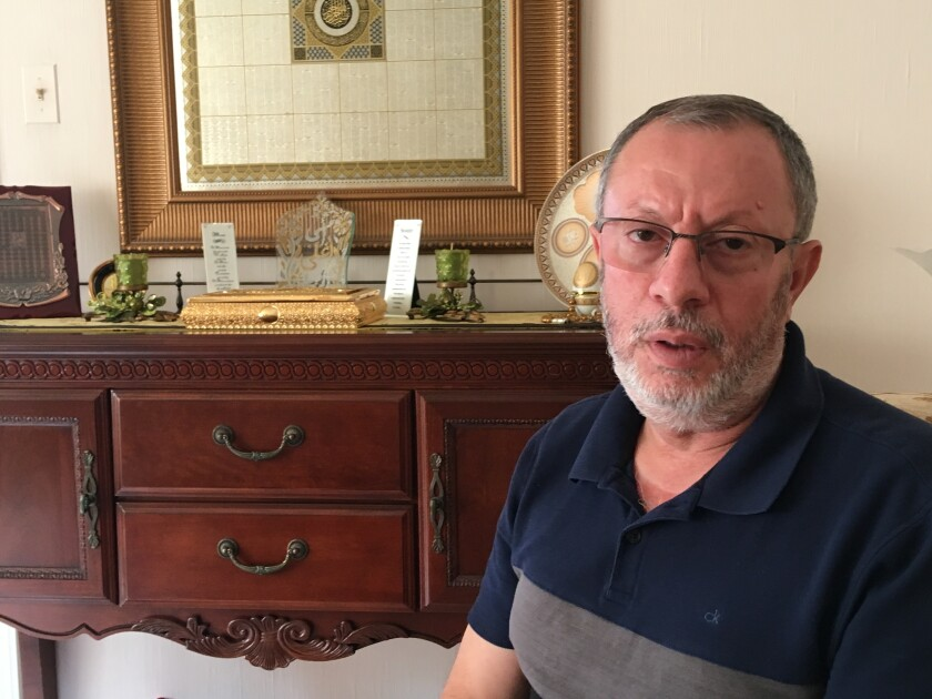 Abdelhaleem Ashqar sits in his Springfield, Va., home, Thursday, Sept. 12, 2019, discussing his deportation case. The U.S. government tried to deport him via Israel earlier this year, but a judge's order forced the U.S. to reverse course on a Tel Aviv tarmac and bring the Palestinian activist back to Virginia while his case gets sorted out. (AP Photo/Matthew Barakat