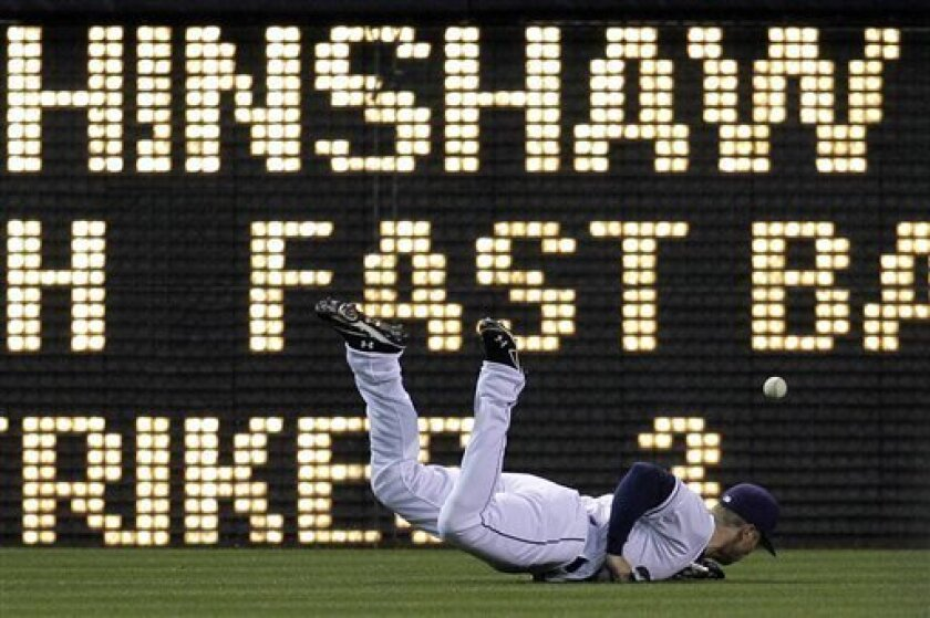 San Diego Padres outfielder James Darnell misses a catch off a hit by Los Angeles Dodgers' Tony Gwynn in the sixth inning during their baseball game Thursday, May 17, 2012, in San Diego. Gwynn doubled on the play.  (AP Photo/Gregory Bull)