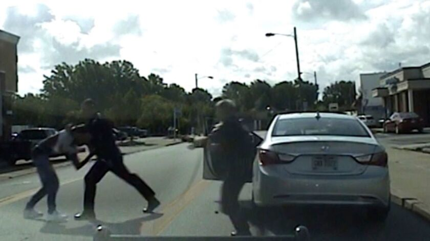 In an image from dashcam video, Euclid, Ohio, police Officer Michael Amiott grabs Richard Hubbard.