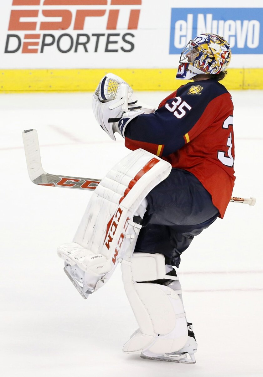 Florida Panthers goalie Al Montoya celebrates after stoping the last shot during a shootout in an NHL hockey game against the Pittsburgh Penguins, Monday, Feb. 15, 2016 in Sunrise, Fla. The Panthers defeated the Penguins 2-1. (AP Photo/Wilfredo Lee)