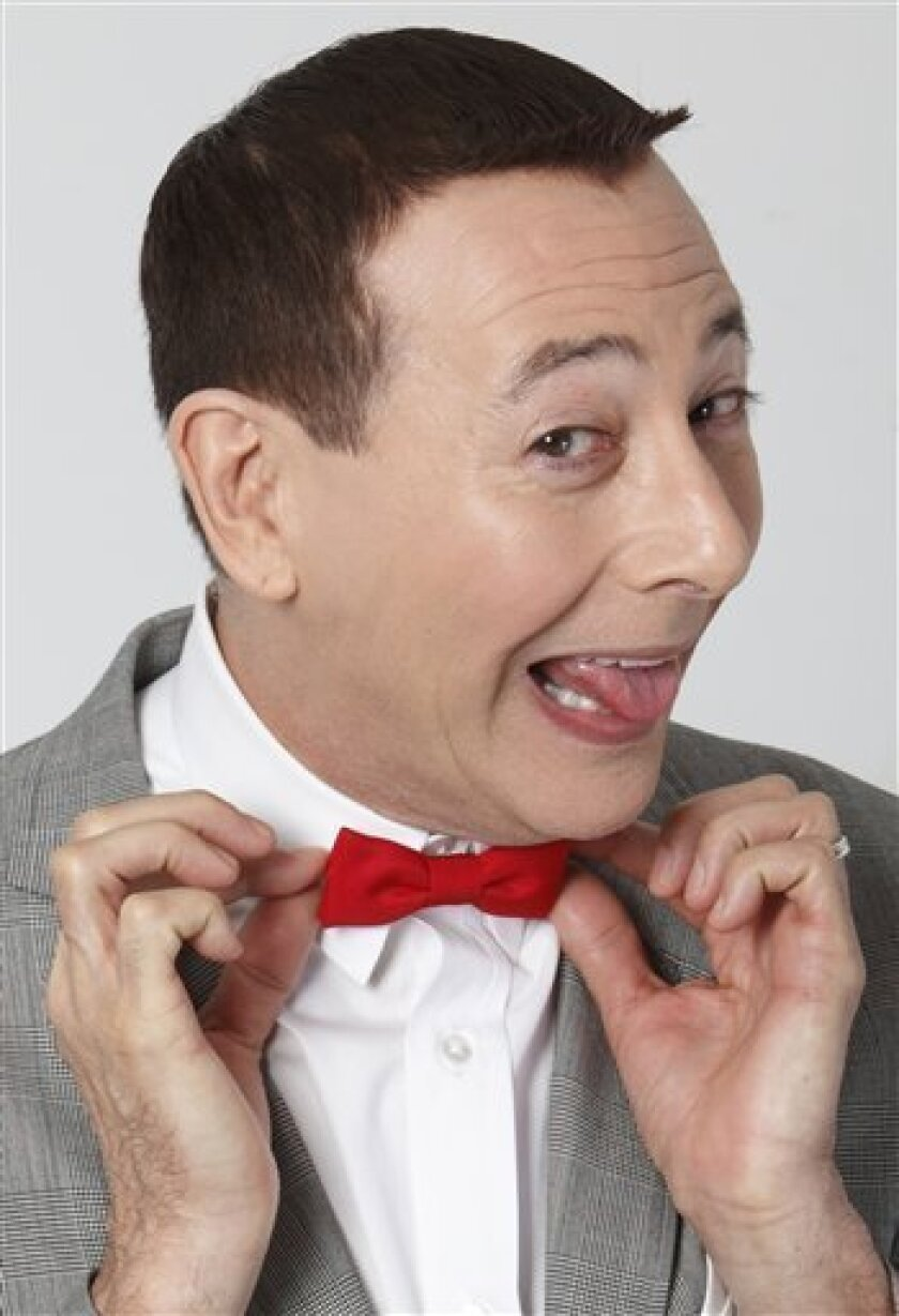 "Actor Paul Reubens portraying Pee-wee Herman poses for a portrait while promoting ""The Pee-wee Herman Show"" live stage play, Monday, Dec. 7, 2009, in Los Angeles. The play will begin a limited engagement on Jan. 12, 2010 through Feb. 7, 2010 at Club Nokia in Los Angeles. (AP Photo/Danny Moloshok)"
