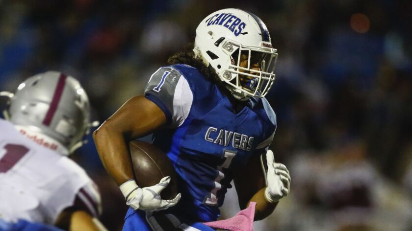 San Diego running back Raiden Hunter (1) rushes up the middle in the first quarter against Kearny.