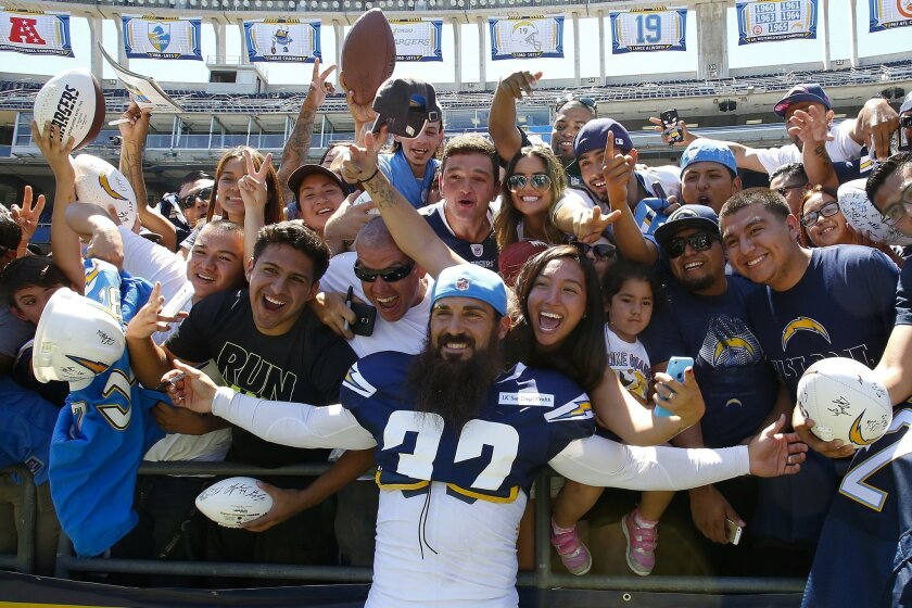 Chargers Eric Weddle posed with fans at Qualcomm Stadium for FanFest 2015.