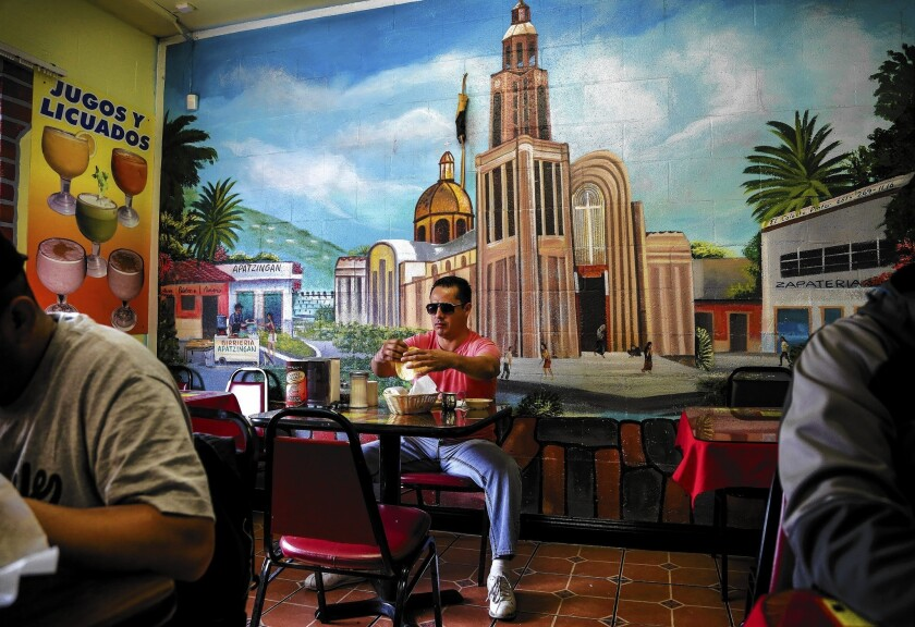 The Birrieria Apatzingan restaurant in Pacoima is named after the city in Michoacan, Mexico, where many of its workers and customers are from. The Knights Templar drug cartel has made that city its stronghold, but civilians are fighting back.