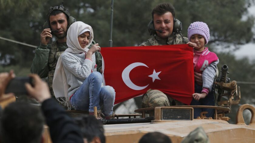 Turkish soldiers pose with Syrian children