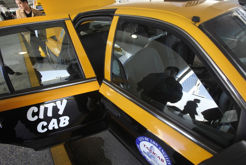 L.A. cab companies reported a 21% drop in taxi trips in the first half of 2014 compared with the same period the previous year.