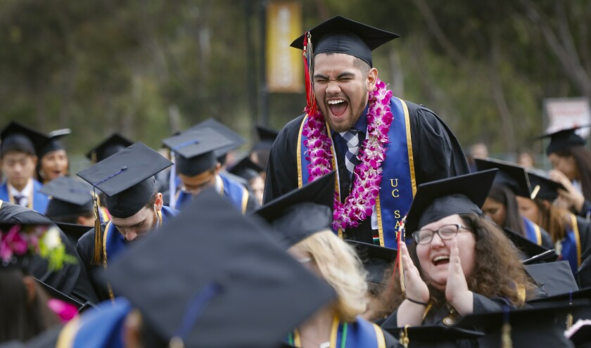 UC San Diego ethnic-studies major David Rodriguez exults during a commencement ceremony in 2019.