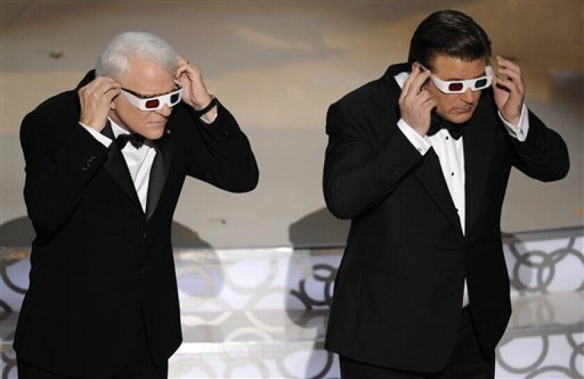 Host Alec Baldwin, right, and Steve Martin are seen on stage at the 82nd Academy Awards Sunday, March 7, 2010, in the Hollywood section of Los Angeles. (AP Photo/Mark J. Terrill)
