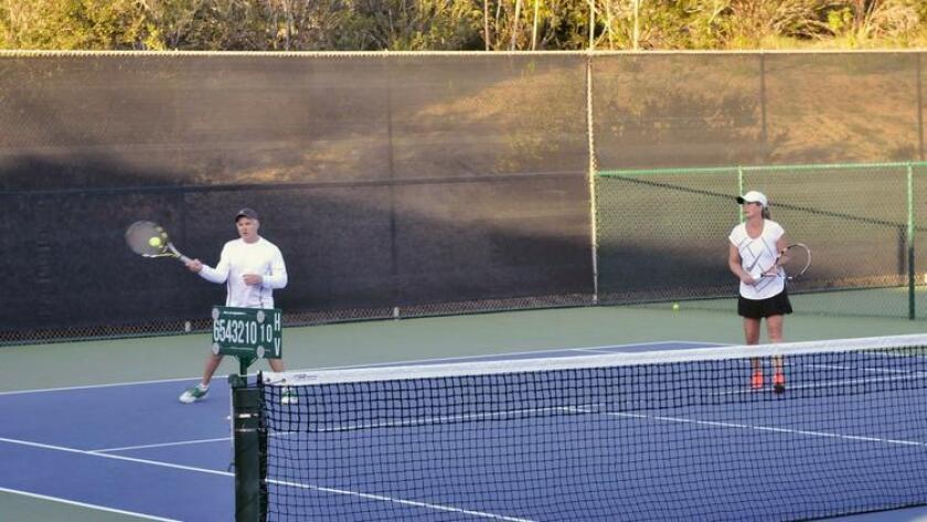 Players enjoy a game at the RSF Tennis Club.
