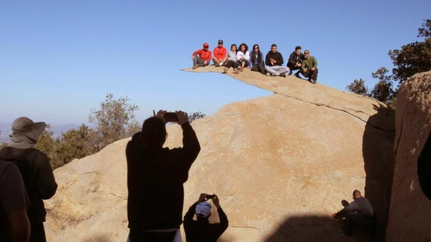 """A selfie or photo of the """"Potato Chip Rock,"""" located high on top of Mt. Woodson, is your reward for climbing 6.6 mile round-trip hike from the Highway 67 trailhead, but you want to come prepared. (Charlie Neuman)"""
