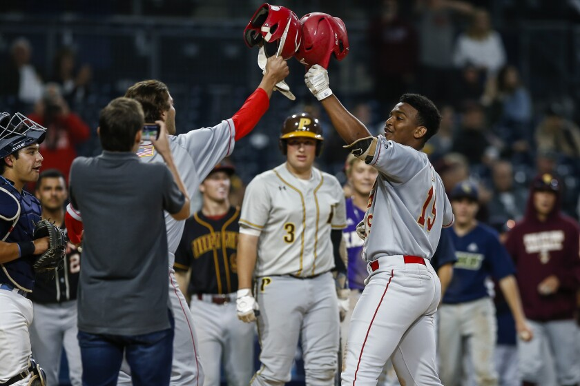 Cathedral Catholic's Zavien Watson celebrates his 2-run home run to put the West up 7-3 in the 8th inning.