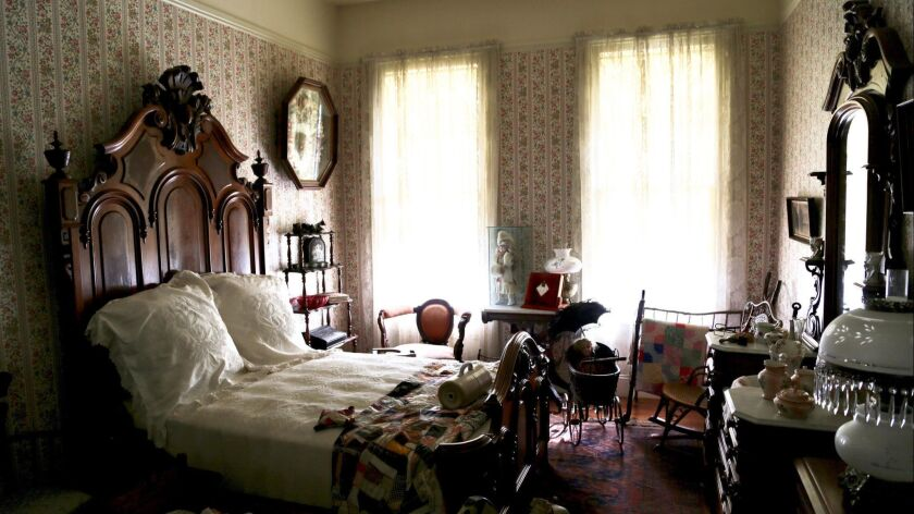 The bedroom interior of a restored Brannan Cottage at The Sharpsteen Museum in Calistoga. The Steven