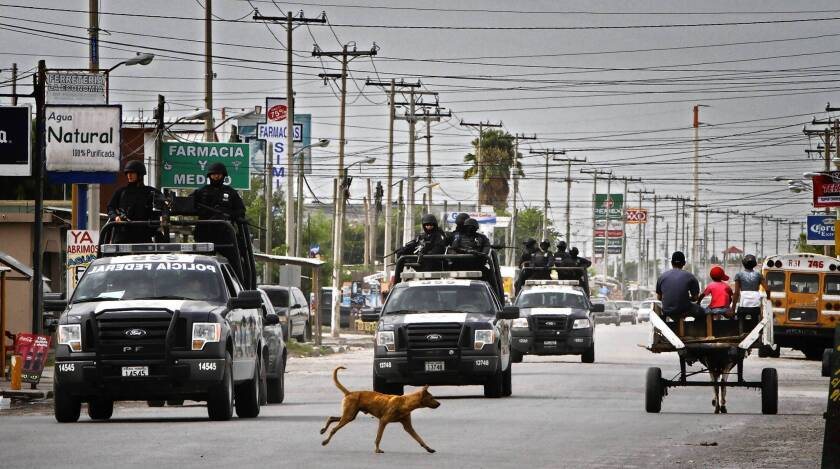 Truckloads of Mexican federal police ride through Matamoros. A corps of specially vetted federal units, as well as Mexican naval special forces, has proved most ready to put aside anti-U.S. sentiment to work closely with American trainers in combating the nation's drug cartels.