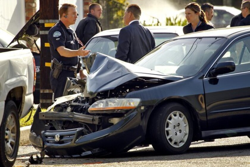 LAPD investigators at the scene of 2011 crash in Los Angeles. A new study found that the 10 ZIP Codes in California with the highest car insurance premiums were in the L.A. metro area.