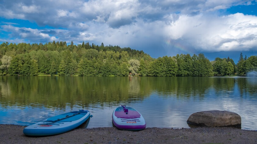 The Lahti local lifestyle of sport and leisure includes paddleboarding on Lake Vesijärvi. It's one of 188,000 lakes that dot the landscape in Finland.