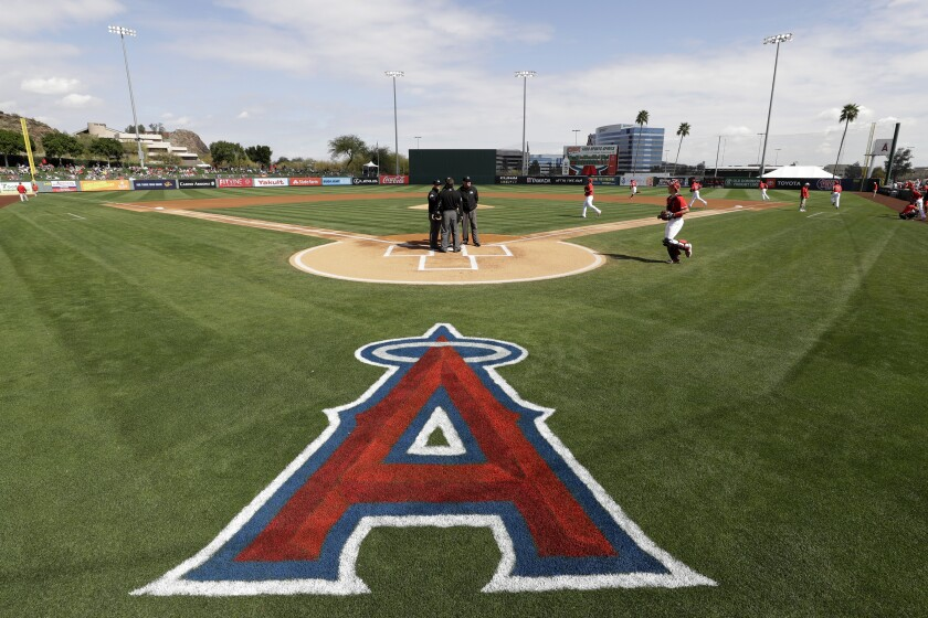 The Angels take the field for their spring training game against the Colorado Rockies on Sunday.