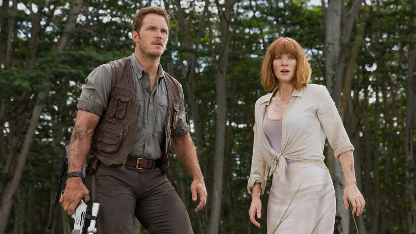 "Chris Pratt and Bryce Dallas Howard star in the 2015 franchise reboot ""Jurassic World."""