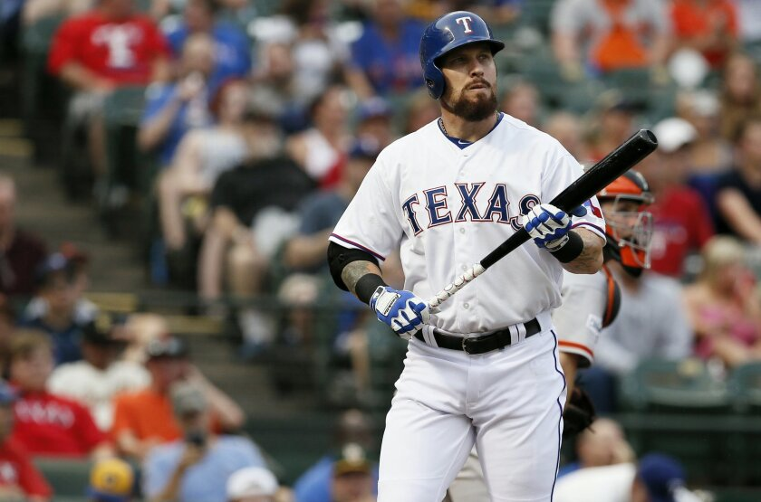 FILE - In this Friday, July 31, 2015 file photo, Texas Rangers' Josh Hamilton during an at bat against the San Francisco Giants in a baseball game in Arlington, Texas. Texas Rangers outfielder Josh Hamilton said Thursday, Feb. 18, 2016 he is dealing with soreness in his left knee after a second sur