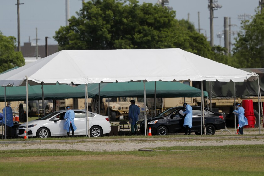 Medical workers screen people in New Orleans