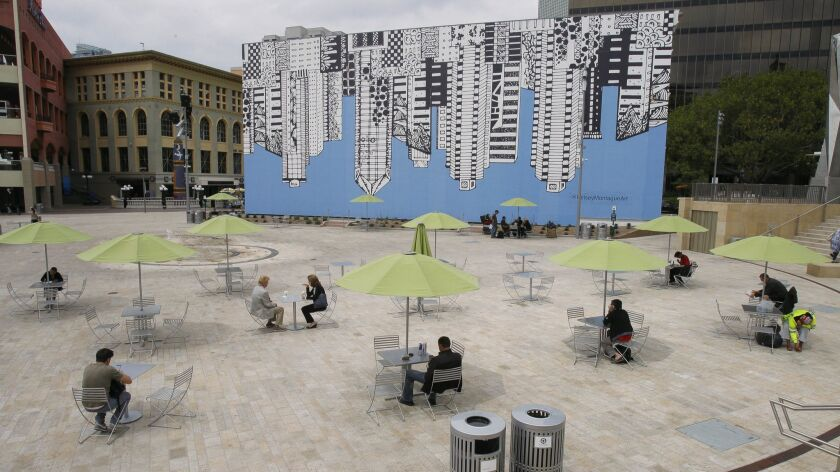 SAN DIEGO, May 25, 2017   People sit at tables at Horton Plaza Park in downtown San Diego on Thursda