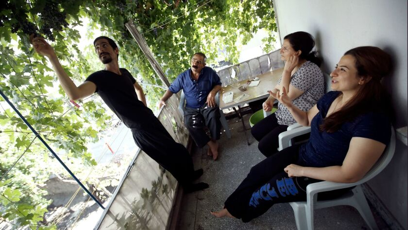 The Moradis on the porch of their friends' home in Turkey.