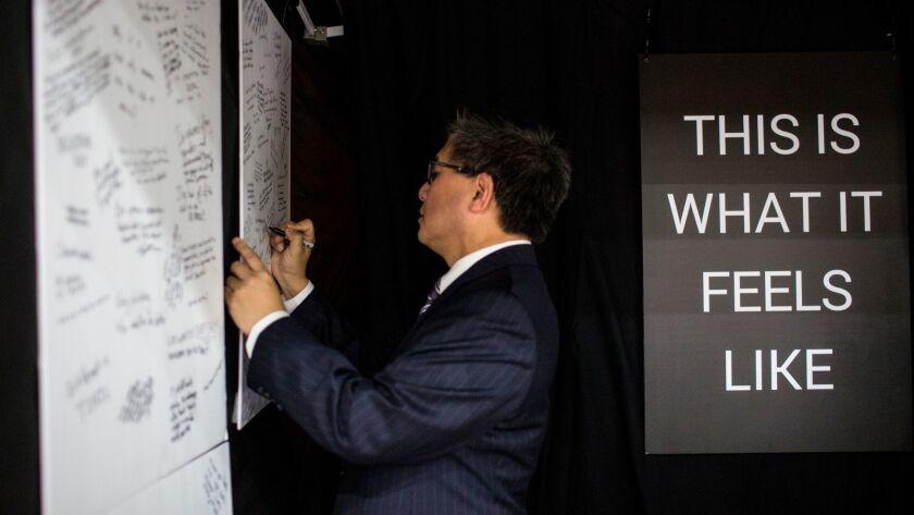 SAN DIEGO, CA - FEBRUARY 23: Democratic Gubernatorial candidate John Chiang writes on a board as par