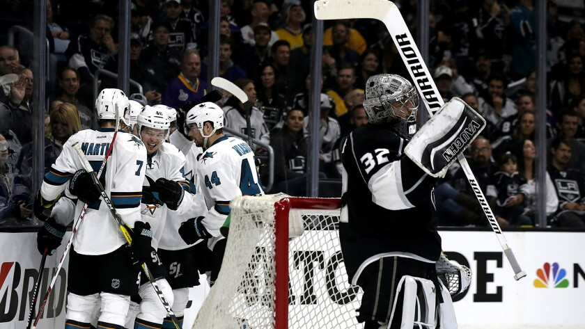 Sharks players celebrate a goal after center Tomas Hertl beat Kings goalie Jonathan Quick during the second period Thursday.