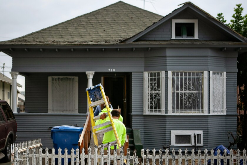 Home on 27th street where clean up and repairs are underway after LAPD detonation of illegal fireworks damaged homes.