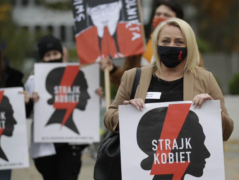 Women's rights activists in Poland protest recent court ruling on abortion.