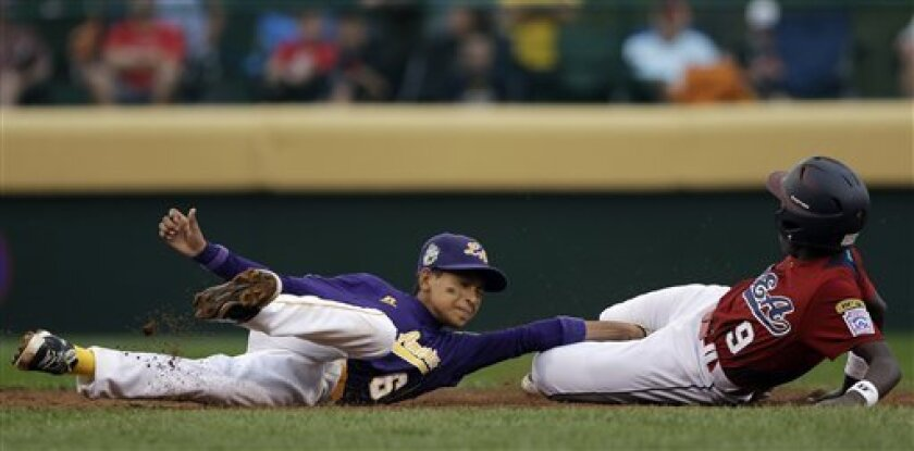 Lugazi, Uganda's Felix Enzama, right, gets tangled up with Aguadulce, Panama's Edwin Nieto after Enzama stole second base in the third inning of a pool play baseball game at the Little League World Series, Friday, Aug. 17, 2012, in South Williamsport, Pa. Panama won 9-3. (AP Photo/Matt Slocum)