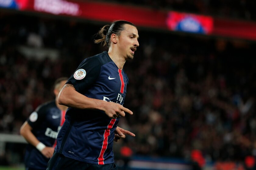 PSG's Zlatan Ibrahimovic celebrates after scoring during his French League One soccer match against Toulouse, at the Parc des Princes stadium in Paris, France, Saturday, Nov. 7, 2015. (AP Photo/Thibault Camus)