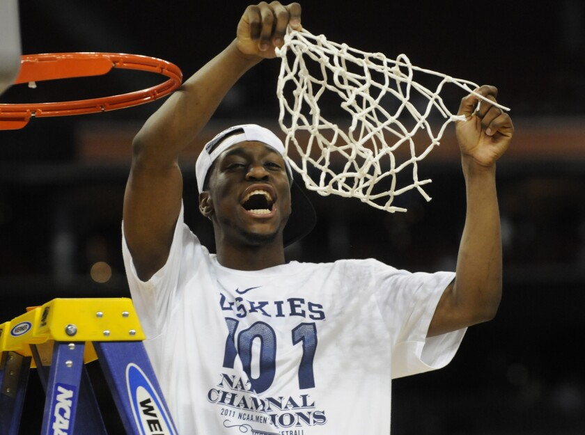 Kemba Walker cuts the final string of the net after leading UConn to the 2011 NCAA tournament title.