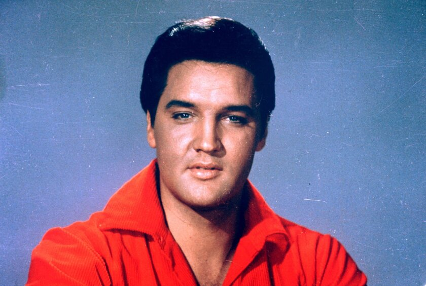 FILE - This 1964 file photo originally released by MGM shows Elvis Presley. Television and radio personality Wink Martindale and Jenna Bush Hager, daughter of former President George W. Bush, attended the annual birthday party at Presley's longtime Memphis home on Wednesday, Jan. 8, 2014. The event