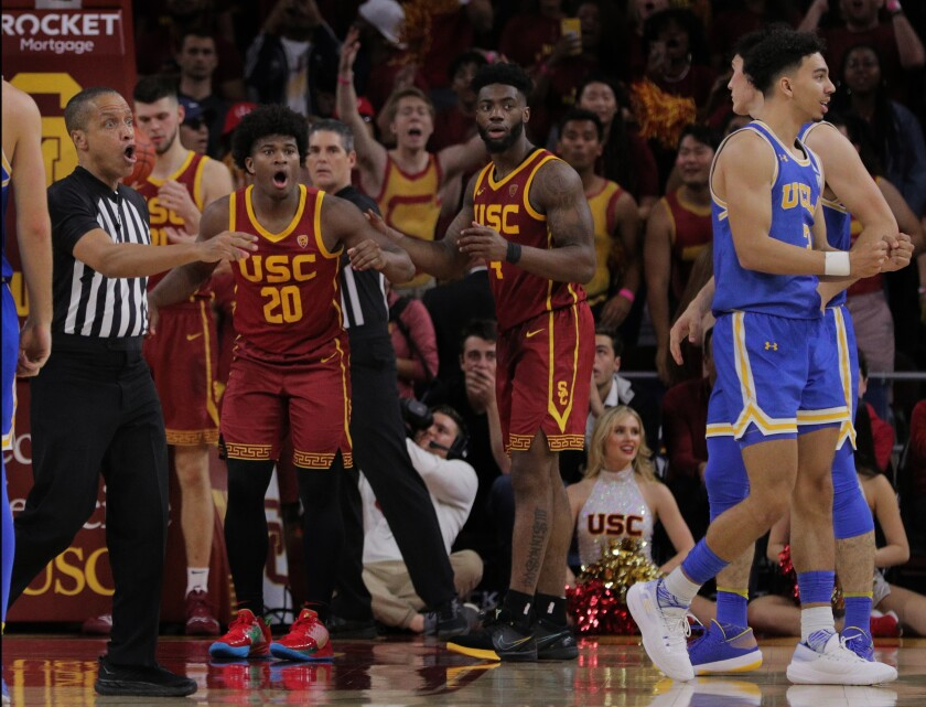 USC guard Ethan Anderson (20) reacts after being called for a foul with nine seconds left in a game against UCLA on March 7 at the Galen Center.