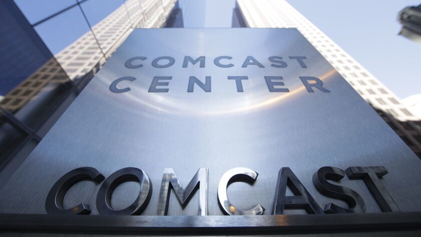 FILE - This March 29, 2017, file photo shows a sign outside the Comcast Center in Philadelphia. Disn