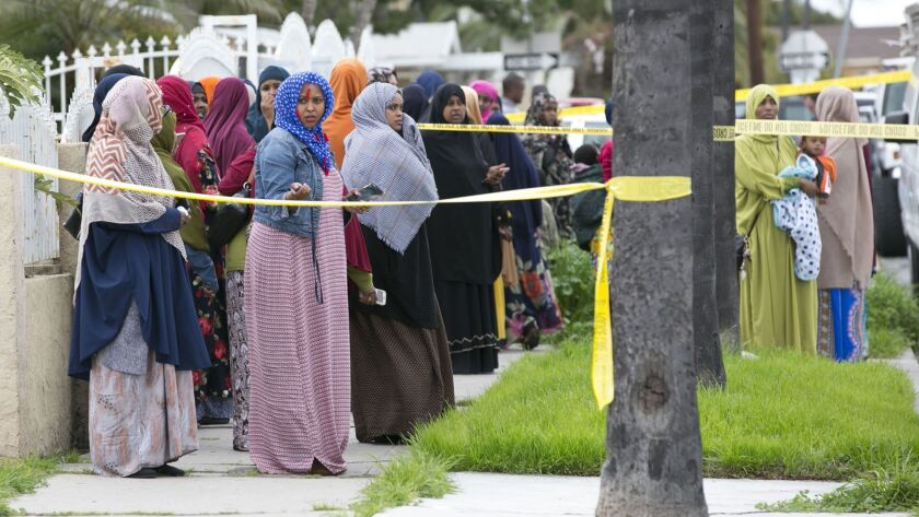 Family members gathered outside a City Heights apartment after a Somali woman was found dead by her sister on Monday.