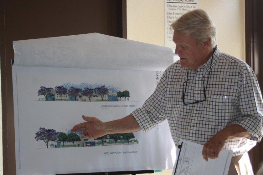 Project architect Jim Alcorn shows renderings of the condominium/retail complex.