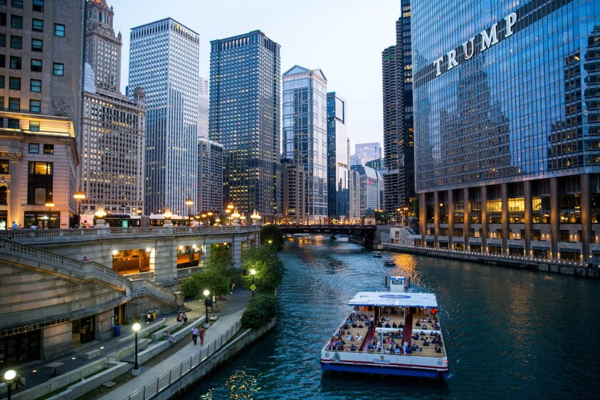 A Shoreline Sightseeing boat cruises along the Chicago River during an architecture boat tour on June 28, 2018.