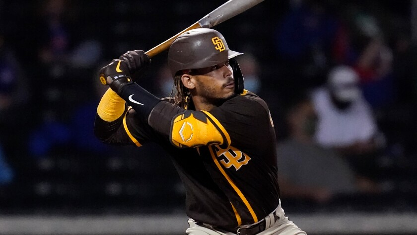 The Padres' Luis Campusano bats during a spring training baseball game