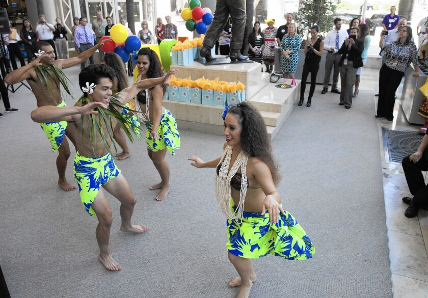 "Polynesian dancers from Tupua Productions in Costa Mesa entertain visitors for an opening celebration of ""Fair Play,"" a new exhibit at John Wayne Airport that looks into the Orange County Fair's 125-year history."