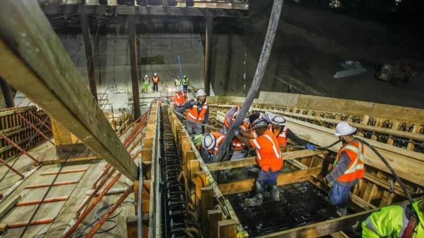 Construction crews pour cement during a nighttime operation at the Gilman Bridge over Interstate 5 in La Jolla, as part of the construction on the Mid-Coast Trolley extension. The roughly 2 billion project is expected to be completed by 2020.
