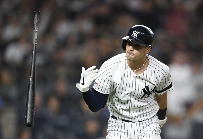 New York Yankees' Tyler Wade flips his bat after hitting a two-run home run during the fifth inning of the team's baseball game against the Toronto Blue Jays, Friday, Sept. 20, 2019, in New York. (AP Photo/Sarah Stier)