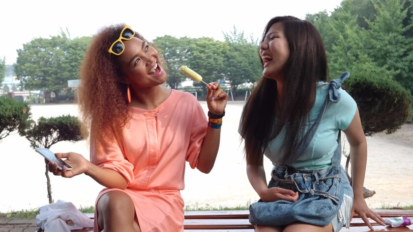 """Crystal Kay, left, and Rosalina Leigh in the movie """"Seoul Searching."""""""