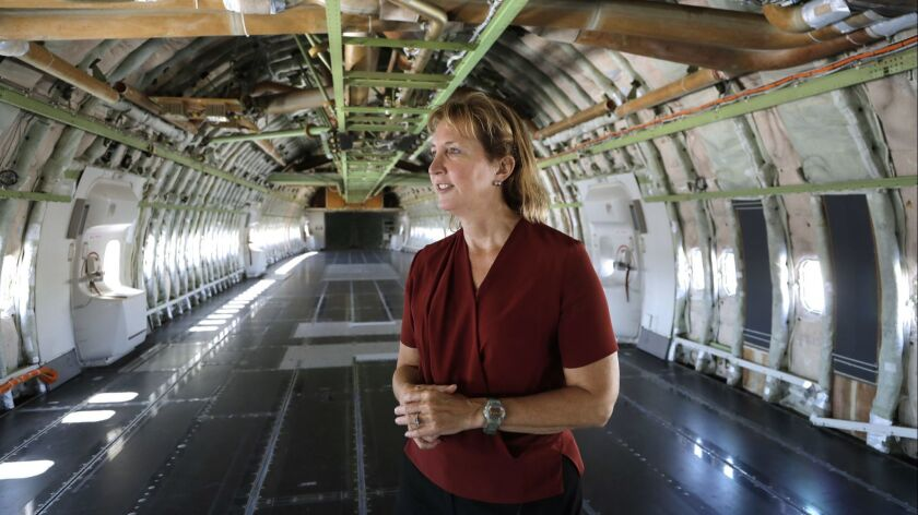 "MOJAVE, CA -- JUNE 14, 2019: Kelly Latimer inside the gutted fuselage of ""Cosmic Girl,"" the modified"