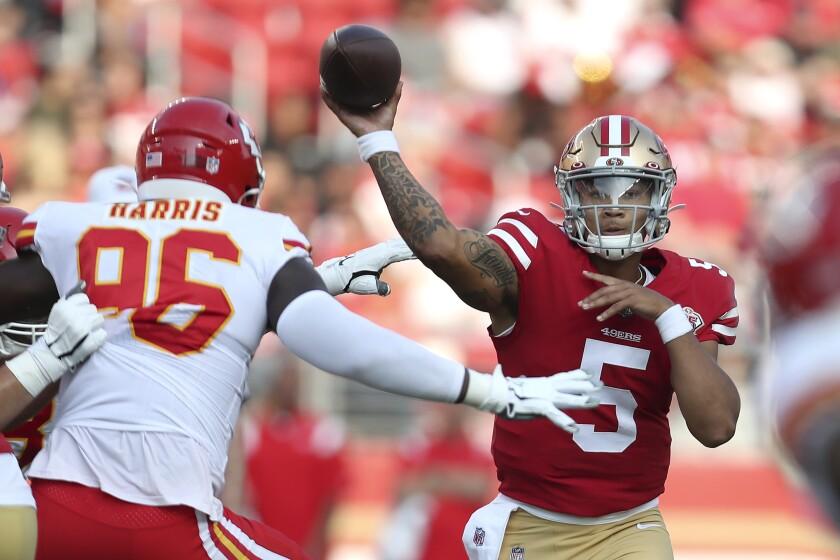 San Francisco 49ers quarterback Trey Lance (5) passes against Kansas City Chiefs defensive end Demone Harris (96) during the first half of an NFL preseason football game in Santa Clara, Calif., Saturday, Aug. 14, 2021. (AP Photo/Jed Jacobsohn)