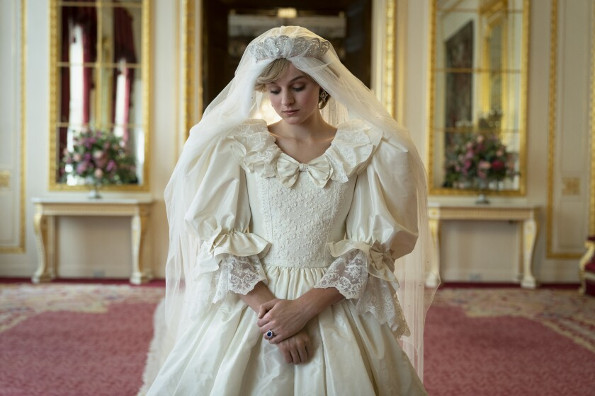 "Emma Corrin as Princess Diana in her wedding gown in ""The Crown."""