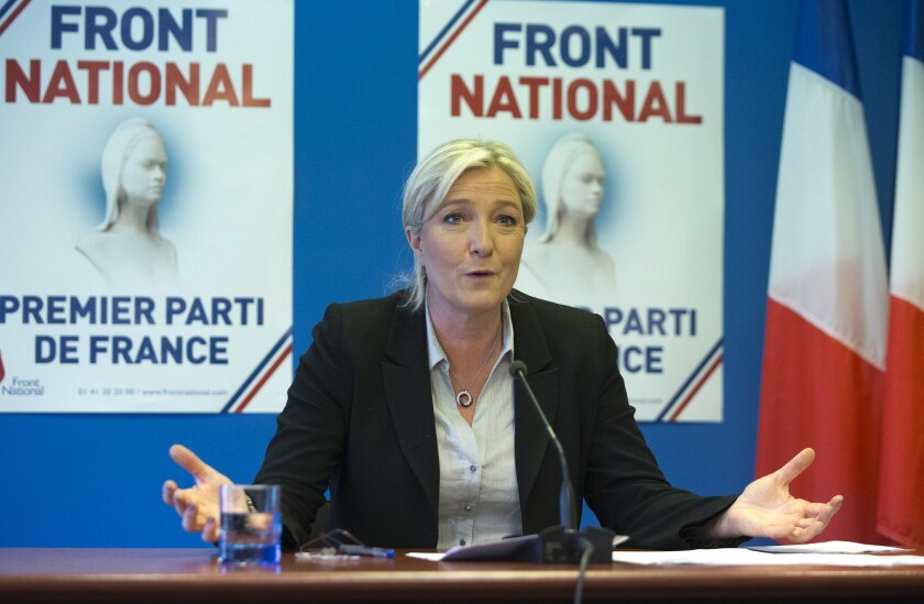 National Front leader Marine Le Pen speaks at party headquarters in Nanterre, west of Paris.