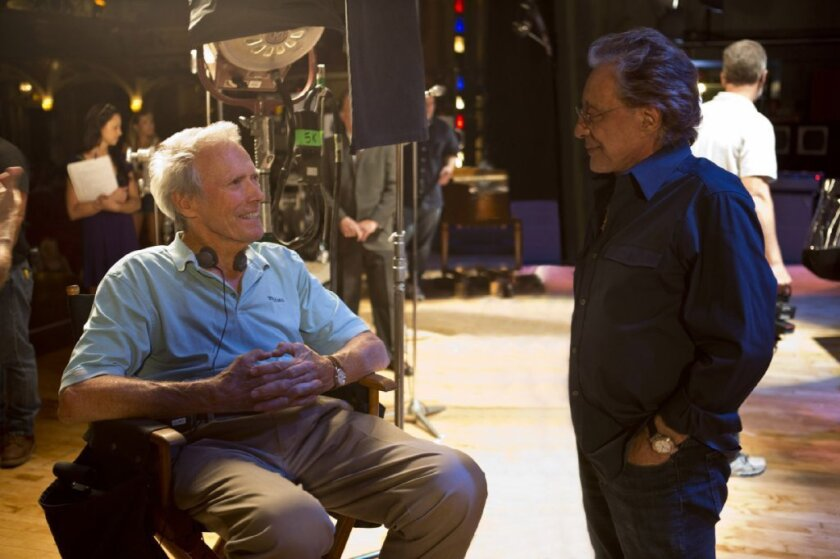 """Clint Eastwood and the real-life Frankie Valli converse on the set of """"Jersey Boys."""""""