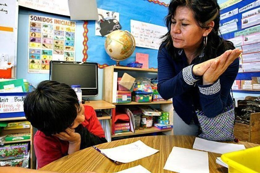 Juana de la Cruz Farias, a teacher at Academia Semillas del Pueblo, teaches Nahuatl, an indigenous language of Mexico, to Anthony Rayo. The Los Angeles Board of Education recently renewed the school's charter despite underperformance on state tests.
