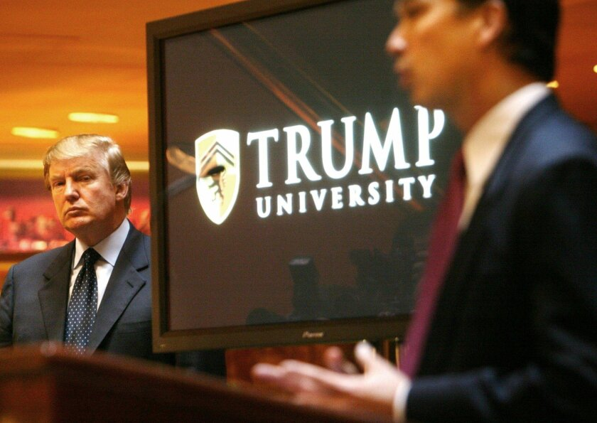 Real estate mogul and reality TV star Donald Trump (left) listens as Michael Sexton introduces him at a news conference in New York where he announced the establishment of Trump University.